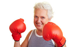 Happy senior woman boxing Stock Images