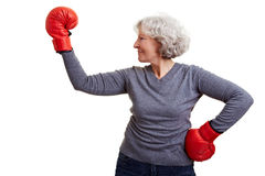 Happy senior woman boxing Stock Image