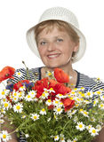 Happy senior woman with bunch of flowers Stock Photography