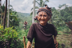 Happy senior woman with a cane in village Royalty Free Stock Photos