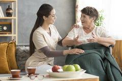 Happy senior woman and caregiver Royalty Free Stock Photo