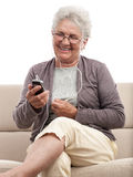 Happy senior woman with cellphone Stock Photo