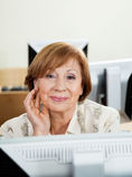 Happy Senior Woman In Computer Class Stock Photo