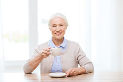 Happy senior woman with cup of coffee Stock Photography