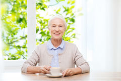 Happy senior woman with cup of coffee Royalty Free Stock Photo