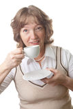 Happy senior woman drinking tea isolated Royalty Free Stock Image