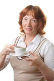 Happy senior woman drinking tea isolated Royalty Free Stock Images