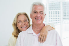 Happy senior woman embracing man from behind Royalty Free Stock Photo