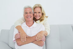 Happy senior woman embracing man from behind Stock Photo