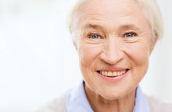Happy senior woman face at home Stock Images