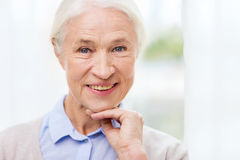 Happy senior woman face at home. Age and people concept - happy smiling senior woman face at home Royalty Free Stock Images