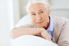 Happy senior woman face at home. Age and people concept - happy smiling senior woman face at home Royalty Free Stock Photo