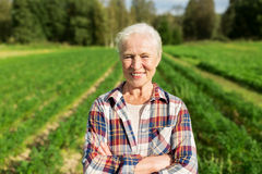 Happy senior woman at farm Stock Photo