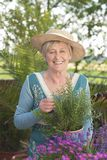 Happy senior woman with flowers Royalty Free Stock Photo