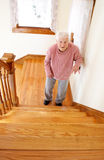 Happy Senior Woman in Front of the Stair Royalty Free Stock Image