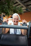 Happy senior woman in gym Royalty Free Stock Photo