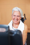 Happy senior woman in gym Stock Image