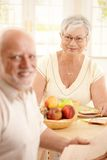 Happy senior woman having breakfast Stock Images