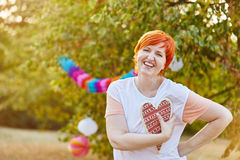 Happy senior woman with a heart on her hand Stock Images