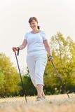 Happy senior woman hiking for rehab training Stock Photos