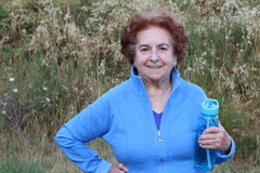 Happy senior woman hiking in the woods stock photography