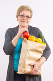 Happy senior woman holding shopping bag with fruits and vegetables, healthy nutrition in old age Royalty Free Stock Photography
