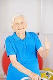 Happy senior woman holding thumbs up Stock Photo
