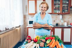 Happy senior woman with fresh crop from her garden Royalty Free Stock Photo