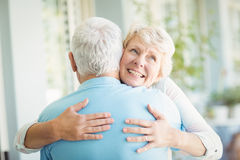 Happy senior woman hugging her husband Royalty Free Stock Photo