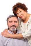 Happy senior woman hugs seat man Stock Photo