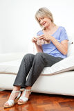 Happy senior woman knitting Stock Photos