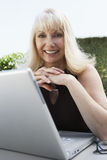 Happy Senior Woman With Laptop Royalty Free Stock Images