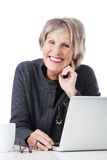 Happy senior woman with laptop Royalty Free Stock Photos