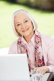 Happy Senior Woman With Laptop At Nursing Home Royalty Free Stock Image