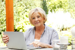 Happy senior woman with laptop Royalty Free Stock Image
