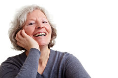 Happy senior woman laughing Stock Photo