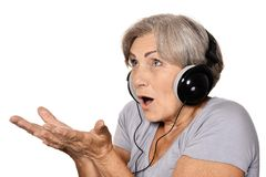Happy senior woman listen a music in headphones Stock Photo