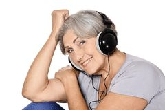 Happy senior woman listen a music Stock Image