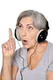 Happy senior woman listen a music in headphones Royalty Free Stock Photo