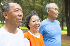 Happy senior woman looking at camera with her brothers Stock Image