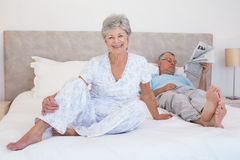 Happy senior woman with man on bed Stock Photography