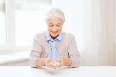 Happy senior woman with medicine at home Royalty Free Stock Images