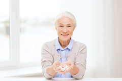 Happy senior woman with medicine at home Royalty Free Stock Image