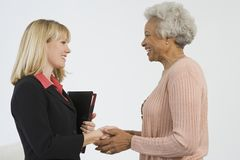Happy Senior Woman Meeting Financial Advisor Royalty Free Stock Image