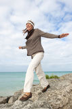 Happy senior woman ocean background Royalty Free Stock Image