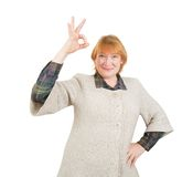Happy senior woman with OK Royalty Free Stock Image