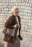 Happy senior woman in the old town Stock Image