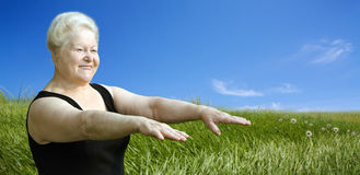 Happy senior woman outdoors Royalty Free Stock Image