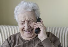 Happy senior woman on phone Stock Photos