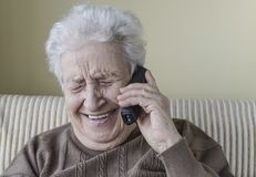 Happy senior woman on phone Royalty Free Stock Photos